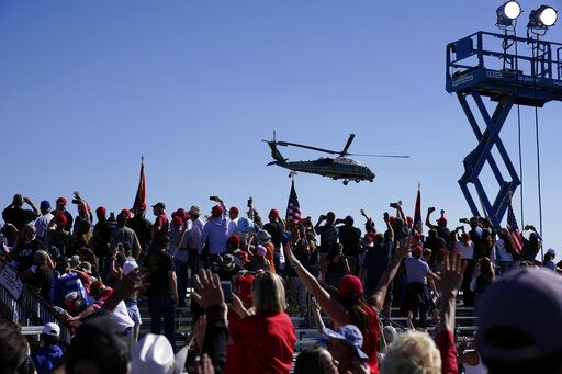 Supporters cheer as Marine One with President Donald Trump departs after a campaign rally at Prescott Regional Airport, Monday, Oct. 19, 2020, in Prescott, Ariz.