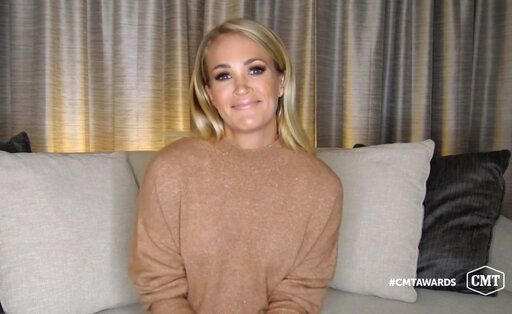 In this video image provided by CMT, Carrie Underwood accepts the female of the year award for 'œDrinking Alone'� during the Country Music Television awards airing on Wednesday, Oct. 21, 2020. (CMT via AP)