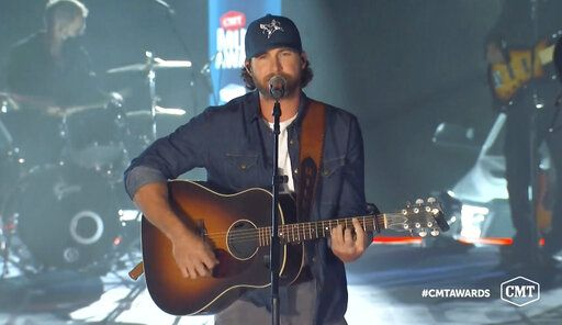 "In this video image provided by CMT, Riley Green performs ""If It Wasn't For Trucks"" during the Country Music Television awards airing on Wednesday, Oct. 21, 2020. (CMT via AP)"