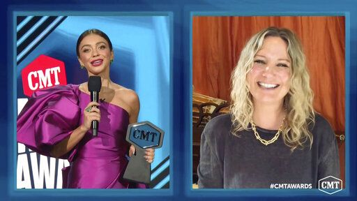 In this video image provided by CMT, Sarah Hyland, left, presents Jennifer Nettles the 'œCMT Equal Play Award'� during the Country Music Television awards airing on Wednesday, Oct. 21, 2020. (CMT via AP)