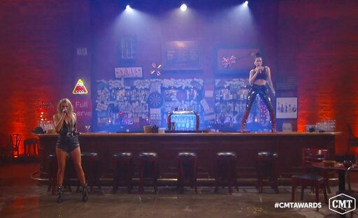 In this video image provided by CMT, Kelsea Ballerini, left, and Halsey perform 'œThe Other Girl'� during the Country Music Television awards airing on Wednesday, Oct. 21, 2020. (CMT via AP)