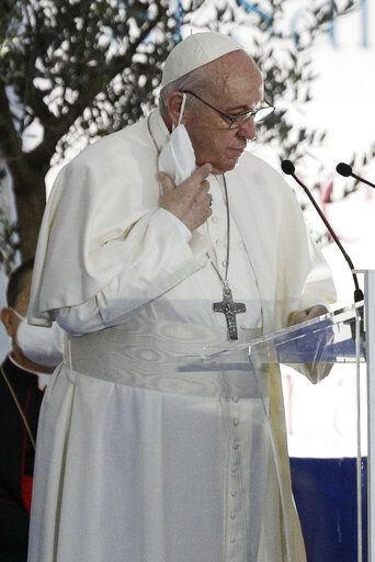 Pope Francis speaks during an inter-religious ceremony for peace in the square outside Rome's City Hall, Tuesday, Oct. 20, 2020