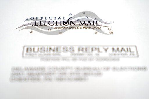 In this Oct. 13, 2020, photo, an envelope of a Pennsylvania official mail-in ballot for the 2020 general election in Marple Township, Pa. The Supreme Court will allow Pennsylvania to count ballots received up to three days after the election, rejecting a Republican plea. The justices divided 4-4 on Oct. 19, an outcome that upholds a state Supreme Court ruling that allowed election officials to receive and count ballots until Nov. 6, even if they don't have a clear postmark.