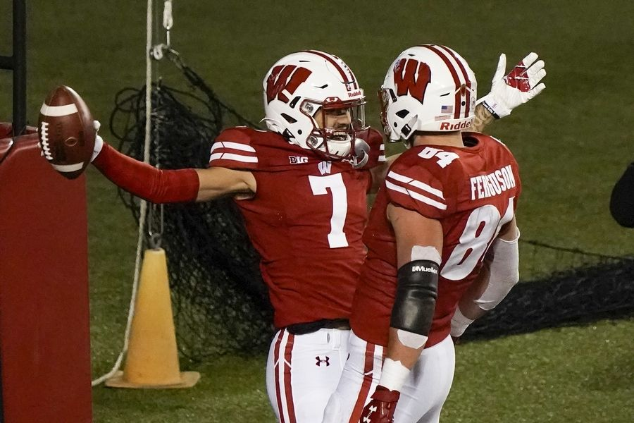 Wisconsin wide receiver Danny Davis III celebrates his touchdown catch with Jake Ferguson (84) during the first half of an NCAA college football game against Illinois Friday, Oct. 23, 2020, in Madison, Wis.