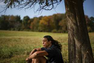 "Annawon Weeden, 46, a member of the Mashpee Wampanoag Tribe, sits for a portrait outside his home in Oakdale, Conn., Friday, Sept. 25, 2020. ""How do you pay somebody for that?"" said Weeden when asked if governments should make financial reparations to Native people. ""The most valuable thing anyone can have or possess ever is time and you don't get that time back. I don't get my ancestors back. It's degrading to think that you could buy your way out of what you put us in. Actions speak for themselves,"" Weeden said. ""You don't got to pay me a dime. Clean up your community, show some respect. Pay the land the respect. It's never about me. It's about this land. I'm only here for a short time. This land had to last a lot longer. Your children are going to have to inherit this. What do you want to leave them? Let's look about our children and how our children's lives are going to turn out because if we can't get things to go better for them, we've all failed."" (AP Photo/David Goldman)"