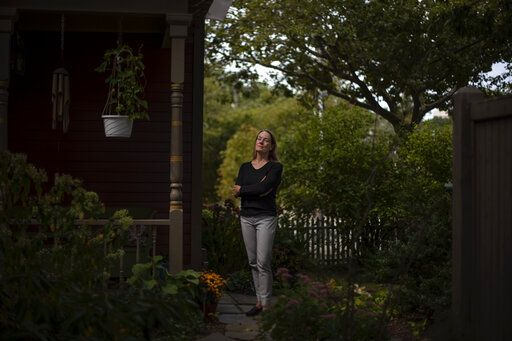 "Charlotte Breed Handy, 57, a direct descendant of a Pilgrim who came over on the Mayflower, stands for a portrait outside her home in Providence, R.I., Tuesday, Sept. 22, 2020. ""When I look back on my ancestry to the Mayflower, I do feel a little bit of ambivalence about it. But I also have a sense of pride about it from that side of my family, my dad's side. But I do feel like there's so much left out in terms of history when you follow a patriarchal line back. You're leaving out all the women that were pulled along the way,"" said Breed Handy. ""I think that while it's good to take pride in your own culture and your own, whatever your feeling part of that, you're careful to respect other people's realities and cultures and way of being in the world, because there are a lot of different ways to be in the world."""