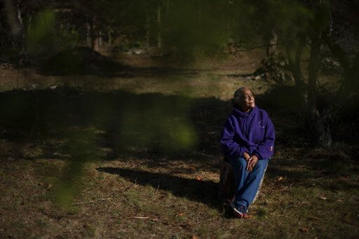 "Hazel Harding Currence, 78, a Herring Pond Wampanoag Tribe Elder, sits for a portrait in her backyard in Bourne, Mass., Tuesday, Oct. 6, 2020. ""We were exposed to disease. We were exposed to slavery. I mean, what happened here was people who came not just for religion, that might have been their purpose of leaving their homeland, but they came here and wanted to wipe out the existence of a whole culture,"" said Currence. ""We should have never been treated the way that we were, our ancestors,"" Currence added. ""I think that if they were here now, if they were looking down on us, I think they'd be very proud at the movement that's going forward now."""