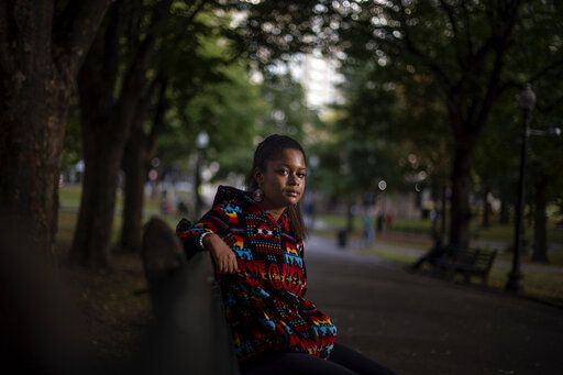 "Alyssa Harris, 18, a member of the Mashpee Wampanoag Tribe, sits for a portrait in a park in Boston, Friday, Oct. 2, 2020. ""I just feel like this is the four hundredth anniversary of colonization. And I mean, why why would I celebrate that? Like, celebrating getting my culture, language, land taken away? Four hundred years ago was the start of all that,"" said Harris who also works as a historical educator. ""But then on top of that, since there's this anniversary, I've been given the opportunity to use my voice, whereas in prior years I've never been asked to. I definitely think people will listen more, especially because there's the Black Lives Matter movement, which is already influencing people to learn more about history."""