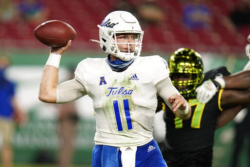 Tulsa quarterback Zach Smith throws a pass against South Florida during the first half of an NCAA college football game Friday, Oct. 23, 2020, in Tampa, Fla.