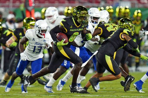 South Florida defensive back Daquan Evans (0) runs with the football after intercepting a pass by Tulsa quarterback Zach Smith during the first half of an NCAA college football game Friday, Oct. 23, 2020, in Tampa, Fla.