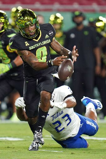 South Florida quarterback Noah Johnson (0) fumbles the football after getting hit by Tulsa linebacker Zaven Collins (23) during the first half of an NCAA college football game Friday, Oct. 23, 2020, in Tampa, Fla. Tulsa recovered the fumble.