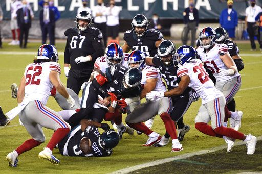 Philadelphia Eagles' Carson Wentz (11) cannot score on a two-point conversion attempt during the second half of an NFL football game against the New York Giants, Thursday, Oct. 22, 2020, in Philadelphia.