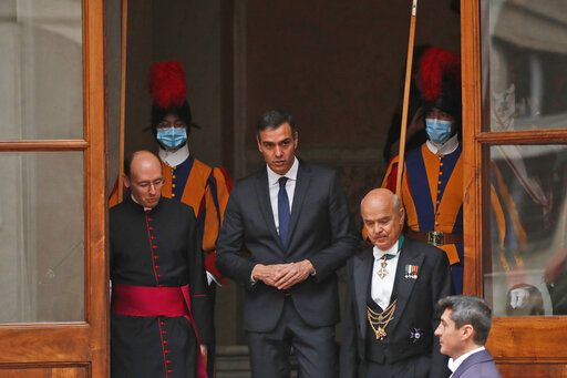 Spain's Prime Minister Pedro Sanchez, center, leaves the San Damaso courtyard after his meeting with Pope Francis, at the Vatican, Saturday, Oct. 24, 2020.