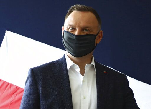 File-File picture taken June 28, 2020 shows Poland's President Andrzej Duda casting his vote during presidential election in Krakow, Poland. Duda was tested positive on Corona.
