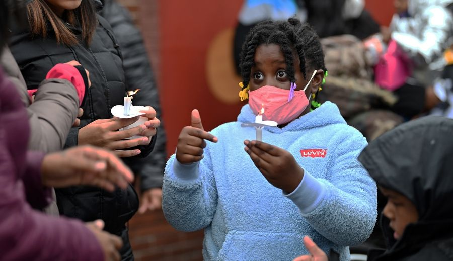 Kay'lyn Bates, 7, of Waukegan, holds a candle Sunday during a prayer vigil in memory of Marcellis Stinnette, a Black teen shot to death by a Waukegan police officer Tuesday.
