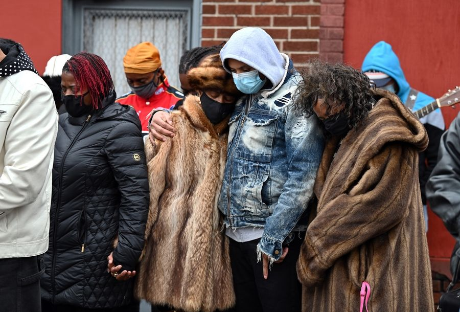 Roderick Stinnette of Waukegan, in gray and denim blue coat, comforts his mother, Sherrellis Stinnette, the grandmother of Marcellis Stinnette, during a prayer vigil Sunday in memory of the Waukegan teen. Marcellis Stinnette was killed Tuesday in a police-involved shooting.
