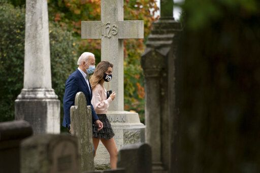 Democratic presidential candidate former Vice President Joe Biden goes to St. Joseph On the Brandywine Roman Catholic Church with his granddaughter Natalie Biden, right, and Finnegan Biden, right, Sunday, Oct. 25, 2020, in Wilmington.