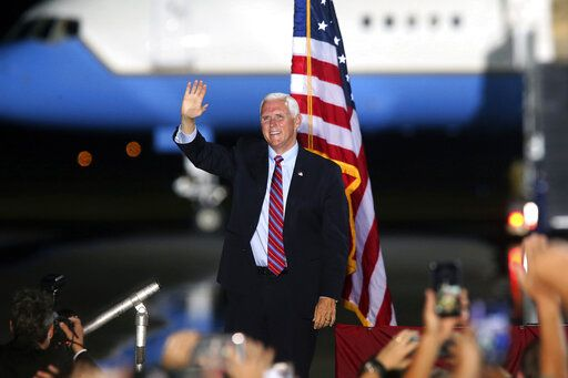 Vice President Mike Pence waves to supporters Saturday Oct. 24, 2020 in Tallahassee, Fla. Battleground Florida was again a central focus of the presidential campaign Saturday as President Donald Trump, Vice President Mike Pence and former President Barack Obama all had high-profile events in the state.