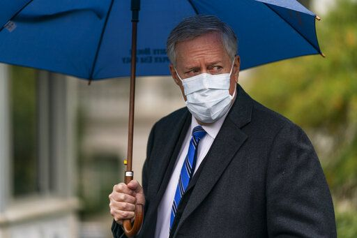 White House chief of staff Mark Meadows responds to reporters questions outside the West Wing on the North Lawn of the White House, Sunday, Oct. 25, 2020, in Washington.