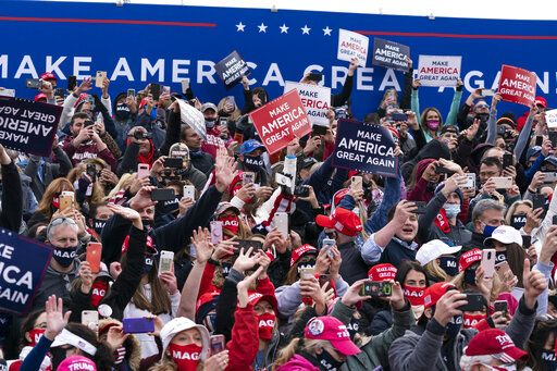 Supporters cheer as President Donald Trump arrives to speak at a campaign rally at Manchester-Boston Regional Airport, Sunday, Oct. 25, 2020, in Londonderry, N.H.