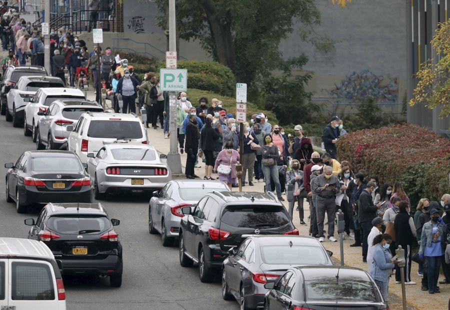 Voters line up Saturday in front of the Yonkers Public Library in Yonkers, New York, as the first day of early voting in the presidential election begins across New York state.