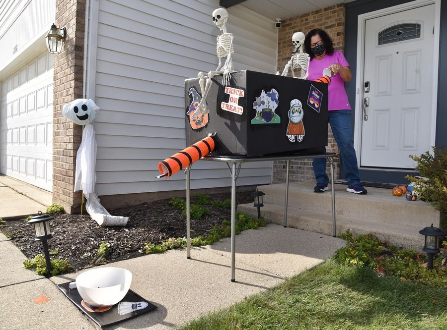 To ensure her family and trick-or-treaters maintain proper physical distance, Debbie Gross of Buffalo Grove devised a delivery system that allows her to feed candy through a 6-foot tube to a waiting trick-or-treater.