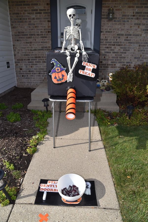 Debbie Gross, of Buffalo Grove, says it cost her about $22 to build her Halloween treat delivery system that allows her to deliver candy to trick-or-treaters through a 6-foot PVC tube.