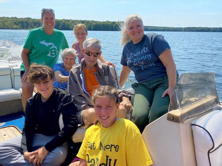 Glen Ekey, center, former executive director of the Naperville Park District, often took trips with friends and family that involved outdoor recreation, such as boating and skiing.