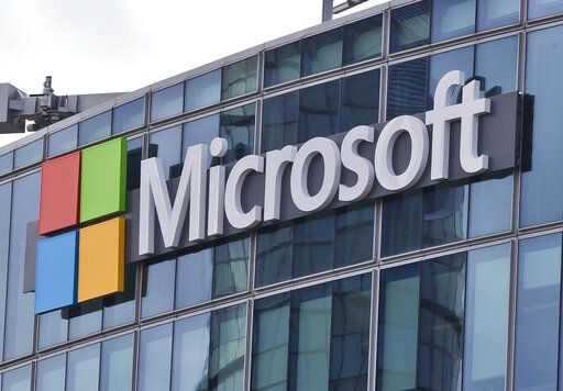 FILE - This April 12, 2016 file photo shows the Microsoft logo in Issy-les-Moulineaux, outside Paris, France. Microsoft took five hours to resolve a major outage of its workplace applications on Monday, but has not clarified what caused the outage. The company said the outage, which affected users' ability to log into Office 365 applications, began early evening Monday Eastern time. Microsoft did not reply to questions Tuesday, Sept. 29, 2020 about what caused the outage, but said on its service-status Twitter account that it had identified a 'œrecent change'� that caused problems.