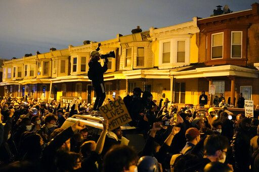 Protesters confront police during a march Tuesday Oct. 27, 2020 in Philadelphia. Hundreds of demonstrators marched in West Philadelphia over the death of Walter Wallace, a Black man who was killed by police in Philadelphia on Monday. Police shot and killed the 27-year-old on a Philadelphia street after yelling at him to drop his knife.