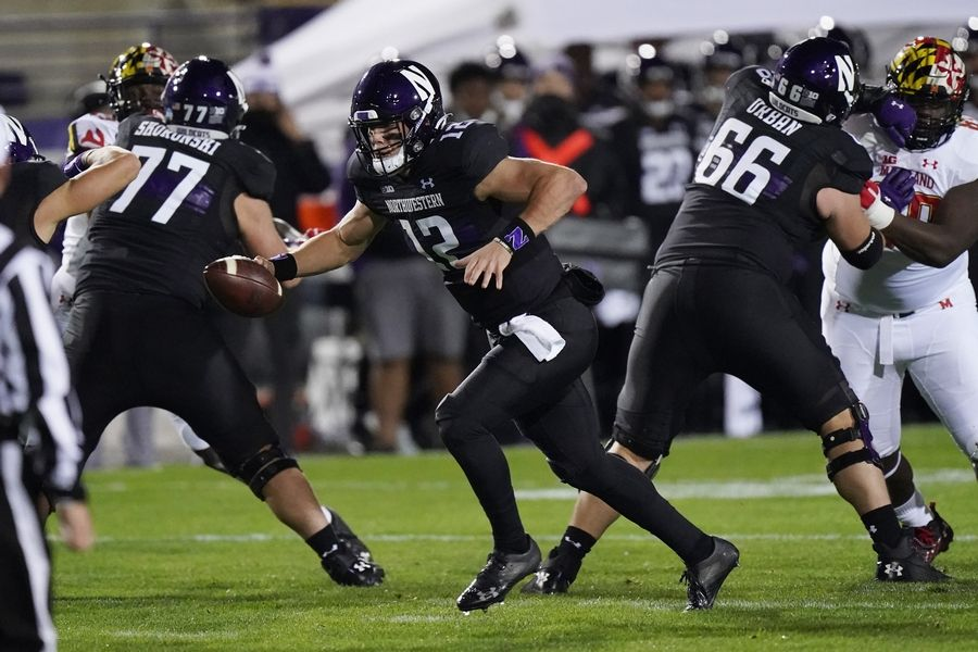 Northwestern quarterback Peyton Ramsey runs with the ball during the first half of an NCAA college football game against Maryland in Evanston, Ill., Saturday, Oct. 24, 2020.