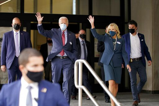 Democratic presidential candidate former Vice President Joe Biden and his wife Jill Biden wave after they voted at the Carvel State Office Building, Wednesday, Oct. 28, 2020, in Wilmington, Del.