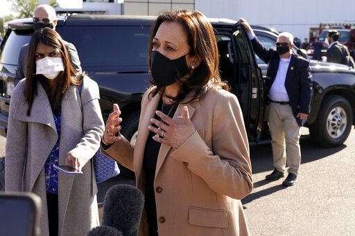 Democratic vice presidential candidate Sen. Kamala Harris, D-Calif., speaks to the media after arriving at Sky Harbor International Airport, Wednesday, Oct. 28, 2020, in Phoenix.