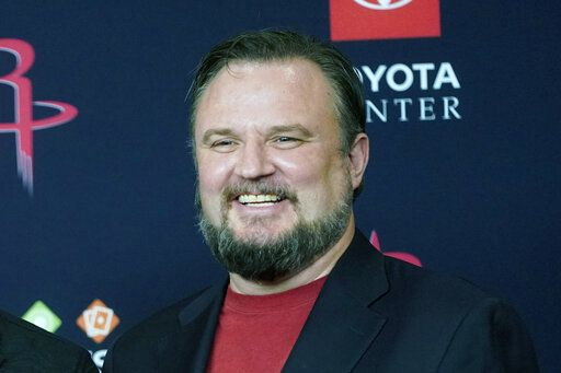 FILE - This is a July 26, 2019, file photo showing Houston Rockets General Manager Daryl Morey during an NBA basketball news conference in Houston. The Philadelphia 76ers are in advanced negotiations with Morey to become president of basketball operations as part of the overhaul of the front office that began after an underachieving season. The deal is expected to be finalized as early as this weekend, multiple people with direct knowledge of the negotiations told The Associated Press on condition of anonymity because it has not been made official. Morey and the Rockets split a little over a year after he sparked a rift between the NBA and Chinese government.