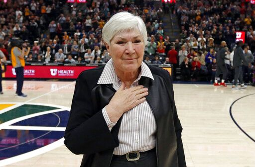 FILE - This March 14, 2019, file photo shows Gail Miller, owner and chairwoman of the Utah Jazz, after addressing the crowd before an NBA basketball game against the Minnesota Timberwolves, in Salt Lake City. The majority interest of the Utah Jazz is being sold to technology entrepreneur Ryan Smith, a move that when formally approved by the NBA will end the Miller family's 35-year run as owners of the franchise. The Jazz said Wednesday, Oct. 28, 2020, that 'œdefinitive agreements'� have been struck with Smith on the sale of the team, Vivint Arena, the team's G League affiliate and management of a Triple-A baseball club. Part of those agreements call for the team to remain in Utah.