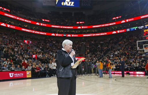 FILE - In this March 14, 2019, file photo, Gail Miller, owner and chairwoman of the Utah Jazz, addresses the crowd before an NBA basketball game against the Minnesota Timberwolves, in Salt Lake City. The majority interest of the Utah Jazz is being sold to technology entrepreneur Ryan Smith, a move that when formally approved by the NBA will end the Miller family's 35-year run as owners of the franchise. The Jazz said Wednesday, Oct. 28, 2020, that 'œdefinitive agreements'� have been struck with Smith on the sale of the team, Vivint Arena, the team's G League affiliate and management of a Triple-A baseball club. Part of those agreements call for the team to remain in Utah.