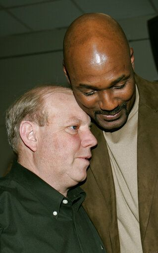 FILE - In this Feb. 13, 2005, file photo, former Utah Jazz power forward Karl Malone gives team owner Larry Miller a hug as they say goodbye after Malone announced his retirement, in Salt Lake City. The majority interest of the Utah Jazz is being sold to technology entrepreneur Ryan Smith, a move that when formally approved by the NBA will end the Miller family's 35-year run as owners of the franchise. The Jazz said Wednesday, Oct. 28, 2020, that 'œdefinitive agreements'� have been struck with Smith on the sale of the team, Vivint Arena, the team's G League affiliate and management of a Triple-A baseball club.