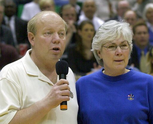 FILE - This April 14, 2004, filer photo shows Utah Jazz team owner Larry Miller and his wife, Gail, thanking the fans prior to the last game of the year game against the Phoenix Suns, in Salt Lake City. The majority interest of the Utah Jazz is being sold to technology entrepreneur Ryan Smith, a move that when formally approved by the NBA will end the Miller family's 35-year run as owners of the franchise.