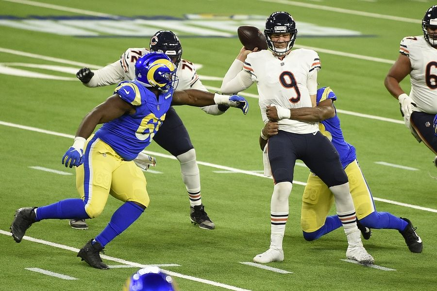 Chicago Bears quarterback Nick Foles is sacked by Los Angeles Rams linebacker Justin Hollins during the second half Monday in Inglewood, Calif.