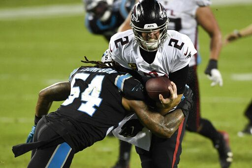 Atlanta Falcons quarterback Matt Ryan gets sacked by Atlanta Falcons linebacker Foye Oluokun during the first half of an NFL football game Thursday, Oct. 29, 2020, in Charlotte, N.C.