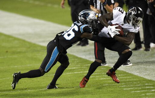 Atlanta Falcons wide receiver Christian Blakeis tackled by Carolina Panthers cornerback Donte Jackson during the first half of an NFL football game Thursday, Oct. 29, 2020, in Charlotte, N.C.