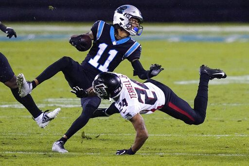 Carolina Panthers wide receiver Robby Anderson is tackled by Atlanta Falcons cornerback A.J. Terrell during the second of an NFL football game Thursday, Oct. 29, 2020, in Charlotte, N.C.