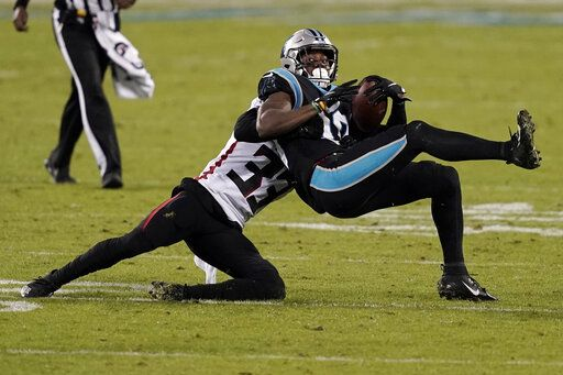 Carolina Panthers wide receiver Curtis Samuel is tackled by Atlanta Falcons cornerback Blidi Wreh-Wilson during the second of an NFL football game Thursday, Oct. 29, 2020, in Charlotte, N.C.