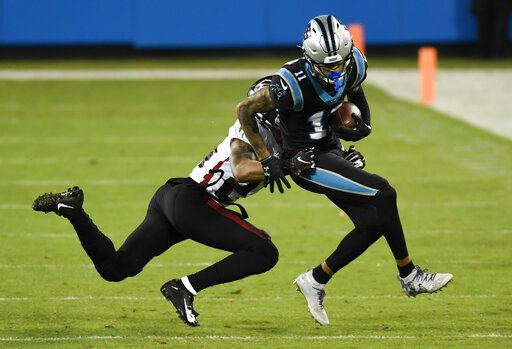 Carolina Panthers wide receiver Robby Anderson is tackled by Atlanta Falcons cornerback A.J. Terrell during the first half of an NFL football game Thursday, Oct. 29, 2020, in Charlotte, N.C.