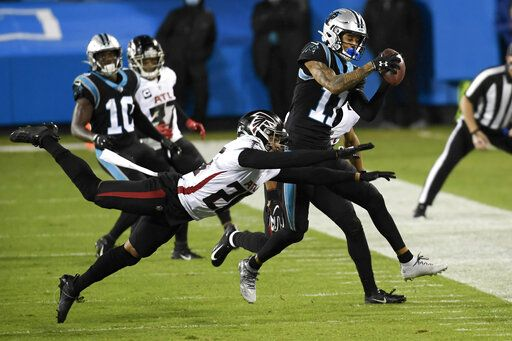 Carolina Panthers wide receiver Robby Anderson is tackled by Atlanta Falcons cornerback Isaiah Oliver during the first half of an NFL football game Thursday, Oct. 29, 2020, in Charlotte, N.C.