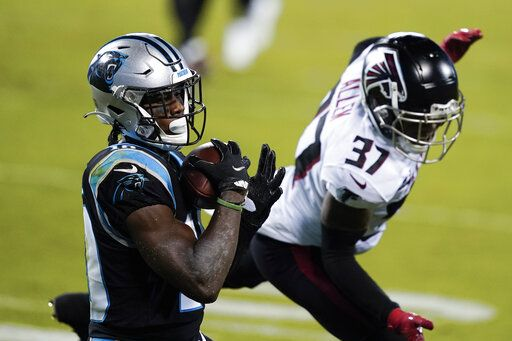 Carolina Panthers wide receiver Curtis Samuel scores past Atlanta Falcons free safety Ricardo Allen during the first half of an NFL football game Thursday, Oct. 29, 2020, in Charlotte, N.C.