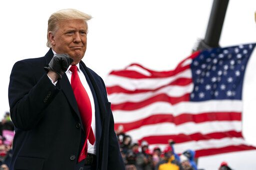 President Donald Trump arrives to speak at a campaign rally at Oakland County International Airport, Friday, Oct. 30, 2020, at Waterford Township, Mich.