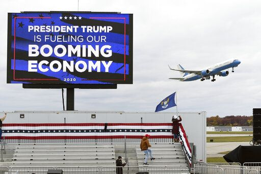Air Force One, with President Donald Trump aboard, takes off from a campaign rally at Oakland County International Airport, Friday, Oct. 30, 2020, in Waterford Township, Mich.