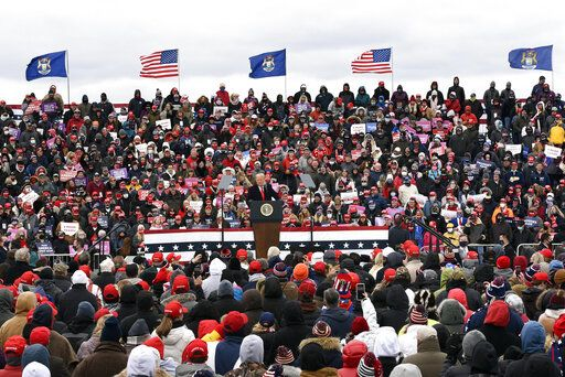 President Donald Trump speaks at a campaign rally at Oakland County International Airport, Friday, Oct. 30, 2020, in Waterford Township, Mich.