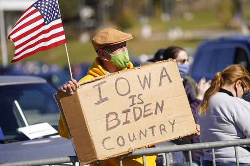 A person holds a sign during a campaign rally for Democratic presidential candidate former Vice President Joe Biden at the Iowa State Fairgrounds in Des Moines, Iowa, Friday, Oct. 30, 2020.